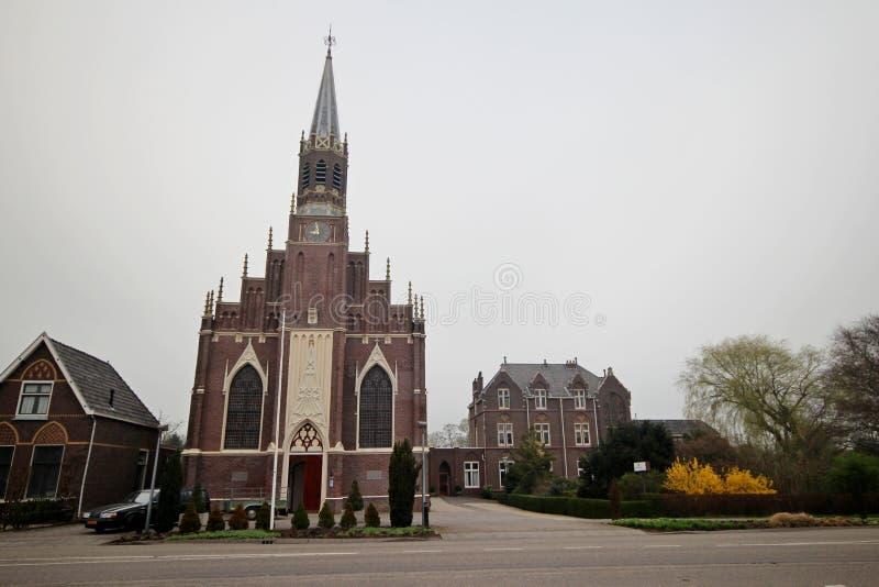 Catholoic church named Scheepjeskerk and vicarage in Hazerswoude Rijndijk in the Netherlands.  royalty free stock photo