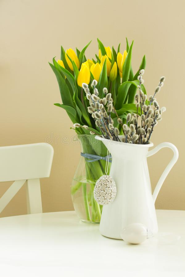 Catkins in pot with easter eggs stock photography
