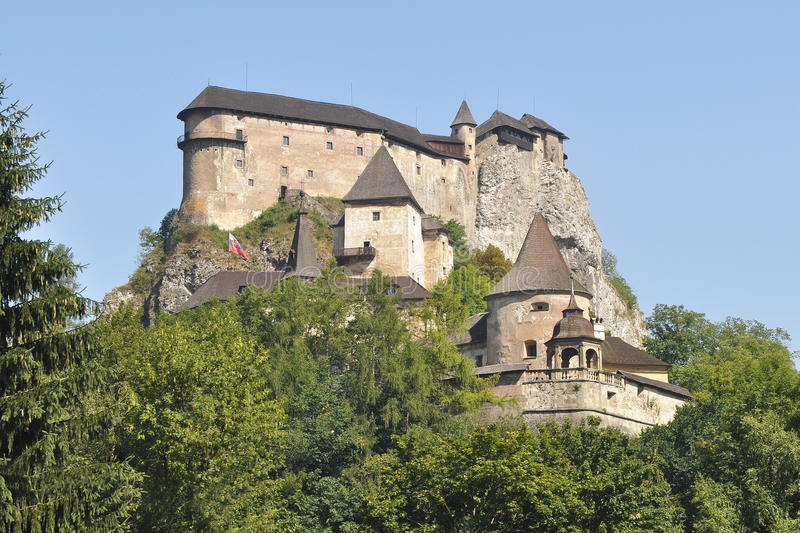 Catle of Orava,Slovakia. Orava Castle on a background of green trees and blue sky royalty free stock images