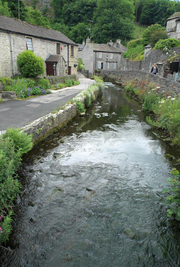 Peakshole Water in Castleton. The stream Peakshole Water running from Peak Cavern in Castleton stock photography