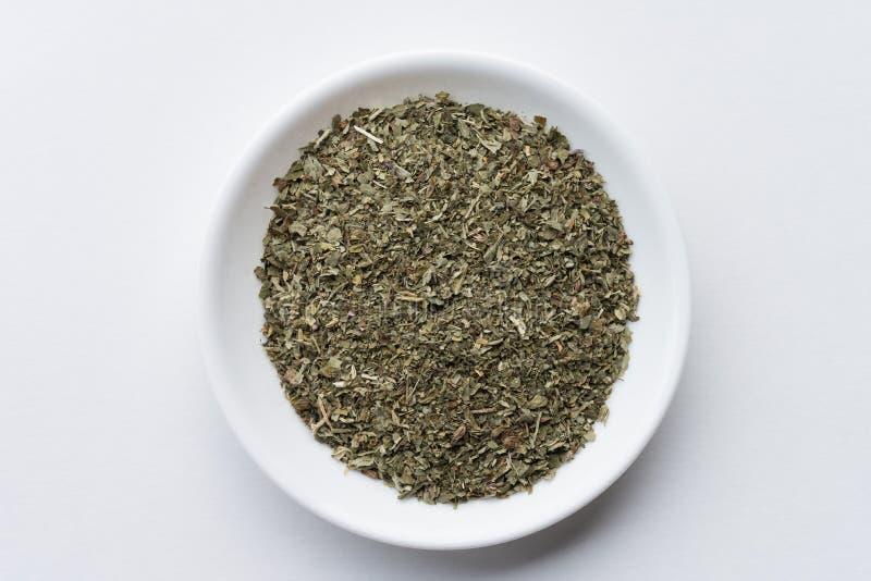Catnip. A bowl of dried ground catnip stock images