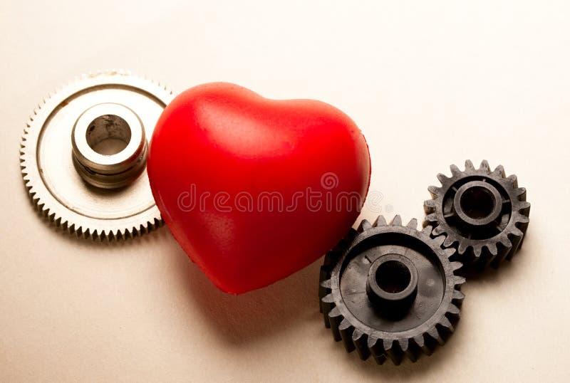 Catracas e coração mecânicos fotografia de stock royalty free