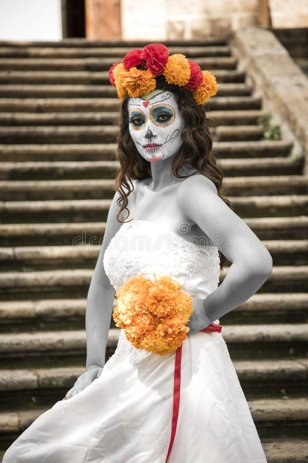 Catrin and Catrina in cemetery. With wedding dresses in an old cemetery of Guadalajara, Mexico royalty free stock photography