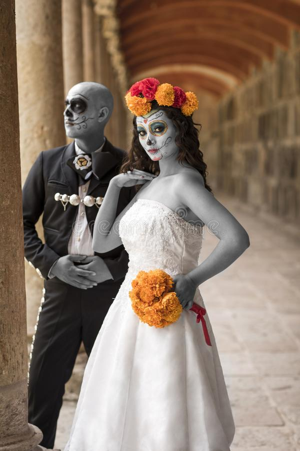 Catrin and Catrina in cemetery. With wedding dresses in an old cemetery of Guadalajara, Mexico royalty free stock photos