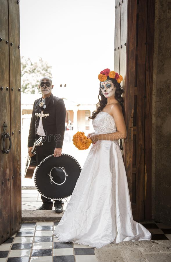 Catrin and Catrina in cemetery. With wedding dresses in an old cemetery of Guadalajara, Mexico royalty free stock image