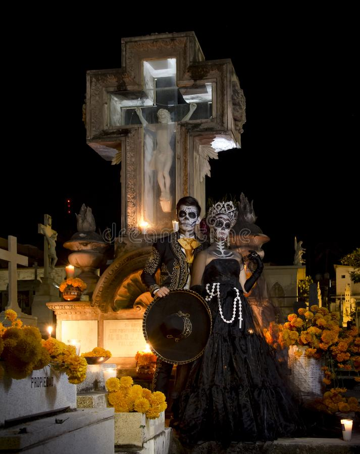 Catrina and catrin at a cementery for the day of the dead celebration in Mexico royalty free stock image