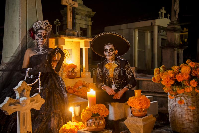 Mexican Catrina and Catrin at a cementery royalty free stock photography