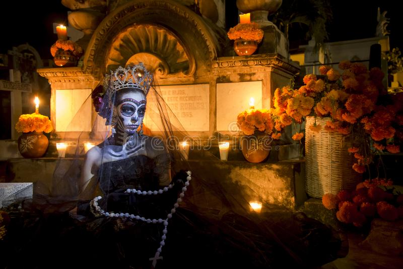 Mexican Catrina  in a cementery for Day of the Dead royalty free stock image