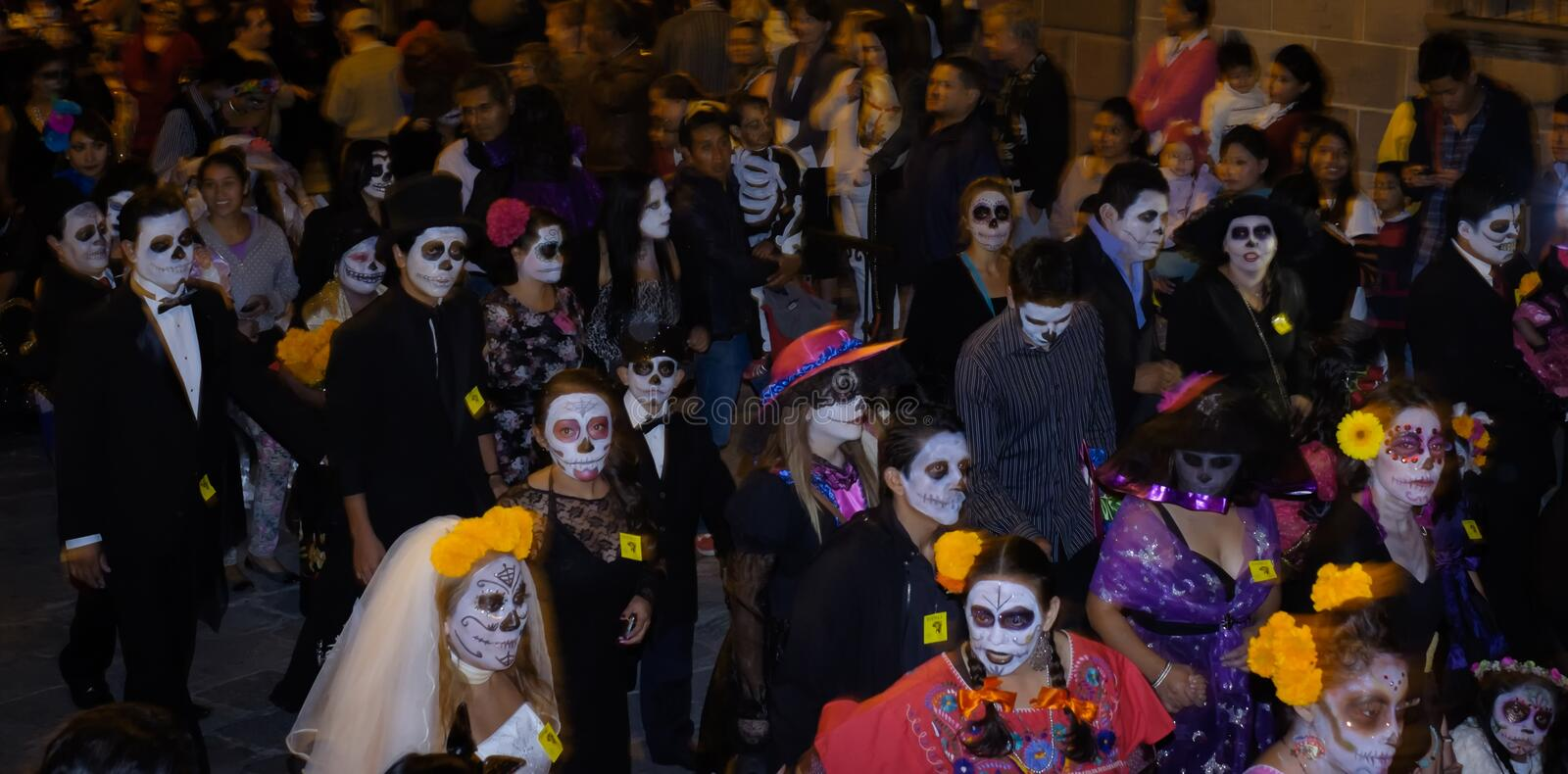 Catrina Parade, Day of the Dead. A Catrina parade celebrating Day of the Dead, in San Miguel de Allende, Mexico, on the night before Halloween stock image