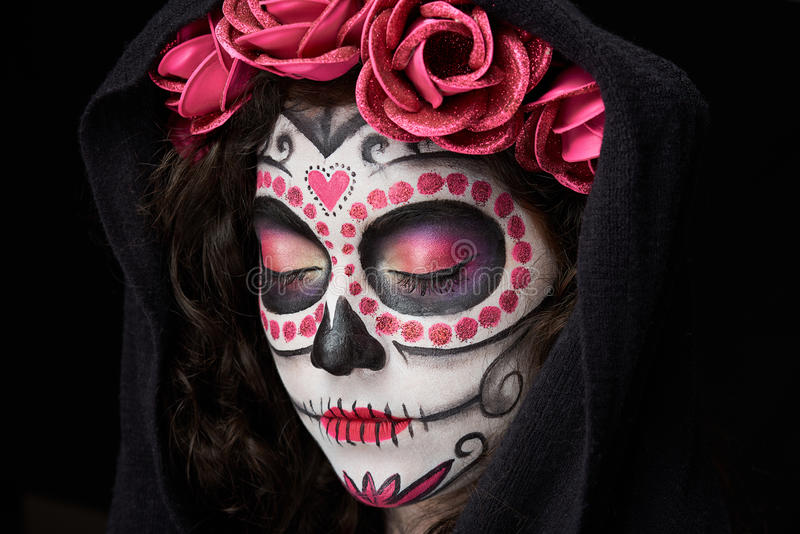 Catrina skull with closed eyes. On black background royalty free stock photography
