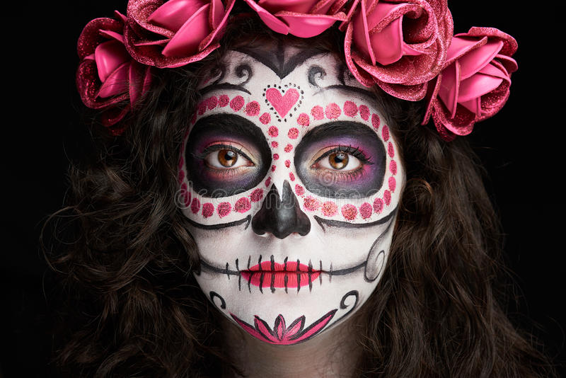 Catrina skull face. Clsoe up portrait of catrina skull face isolated on black royalty free stock photography