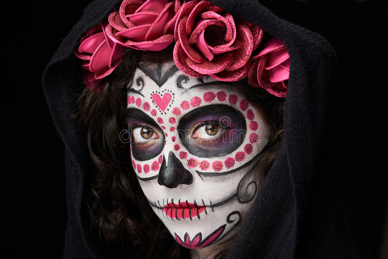 Catrina skull look. Close up of catrina skull look with cloak isolated on black stock photos