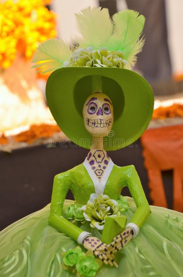 Catrina Portrait. The Catrina is a typical and popular Mexican symbol. Shows the relation that this people has with death and it is becoming in a Mexican image royalty free stock photo