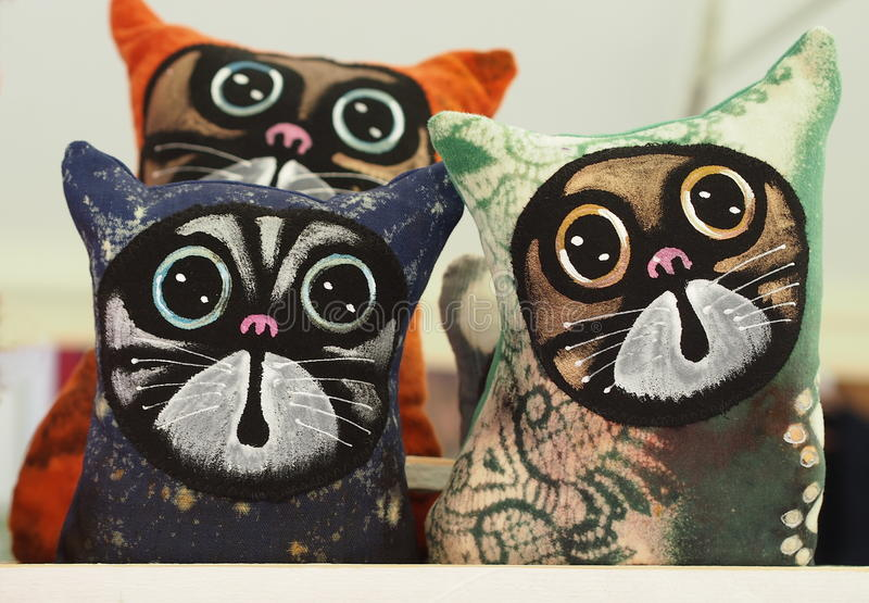 Cats. Cute hand made textile decorations royalty free stock photography
