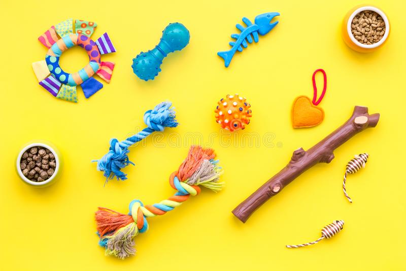Cats and dogs toys and acessories for pets yellow background top view. Cats and dogs toys and acessories for pets on yellow background top view royalty free stock photos