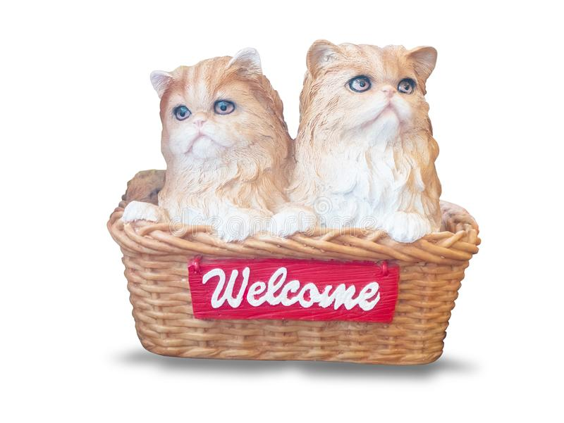 Cats dolls made of ceramic are in the basket,vintage phone , isolated on white background. With clipping path stock photo