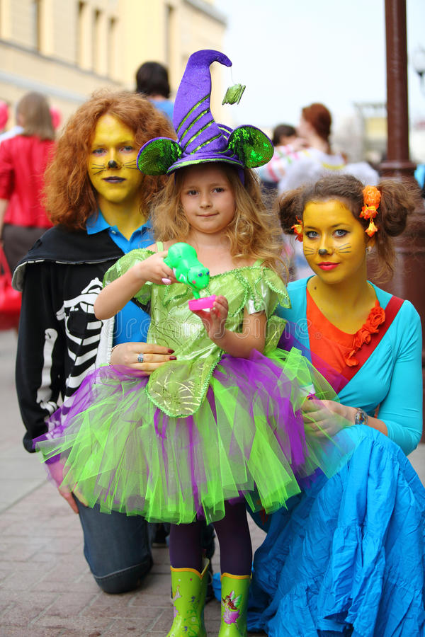 Cats and fairy, adults and children in fancy dress on the holiday. MOSCOW - APRIL 22: Cats and fairy, adults and children in fancy dress on the holiday of spring stock images