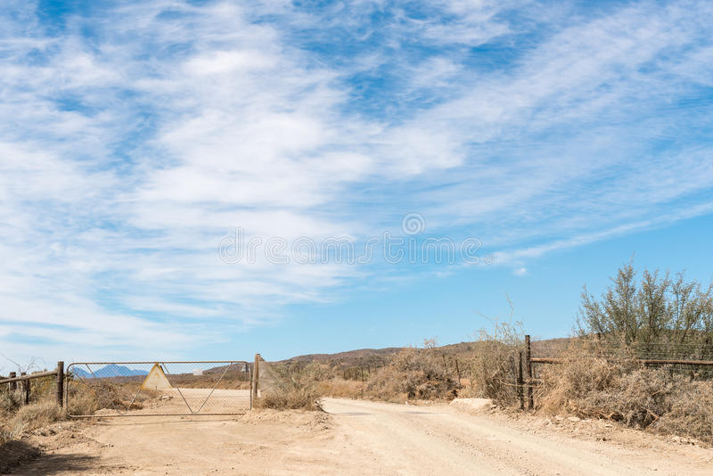 Cattle grid and gate in the Strykhoogte Pass. A cattle grid and gate in the Strykhoogte Pass between McGregor and Bonnievale in the Western Cape Province stock photos