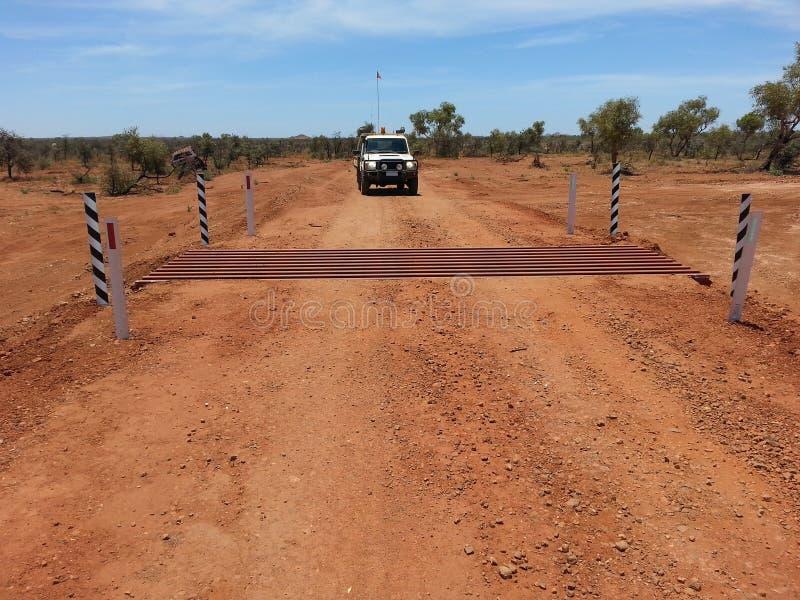 Cattle grid on gravel road in Australian Outback. Newly installed cattle grid on a gravel road in the Australian outback stock image