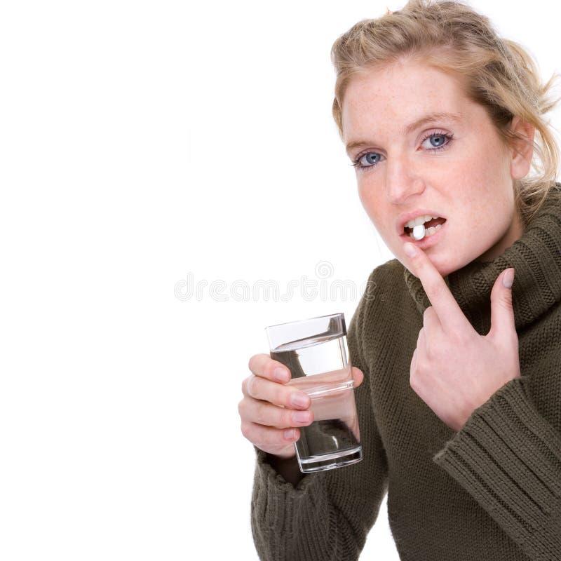 Catturi una pillola immagine stock