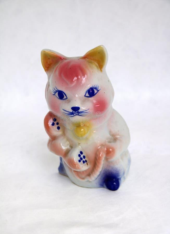 Catty банк для держит монетку, кот носит телефон o стоковые изображения rf