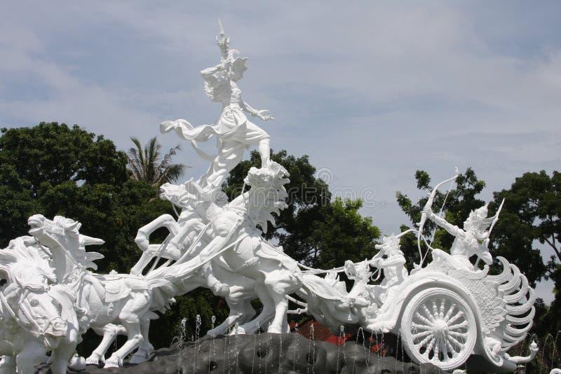 Catur Muka雕象在巴厘岛 图库摄影