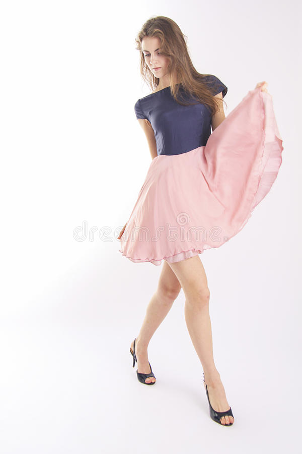 Catwalk model. Beautiful model with blowing hair in dress stock images
