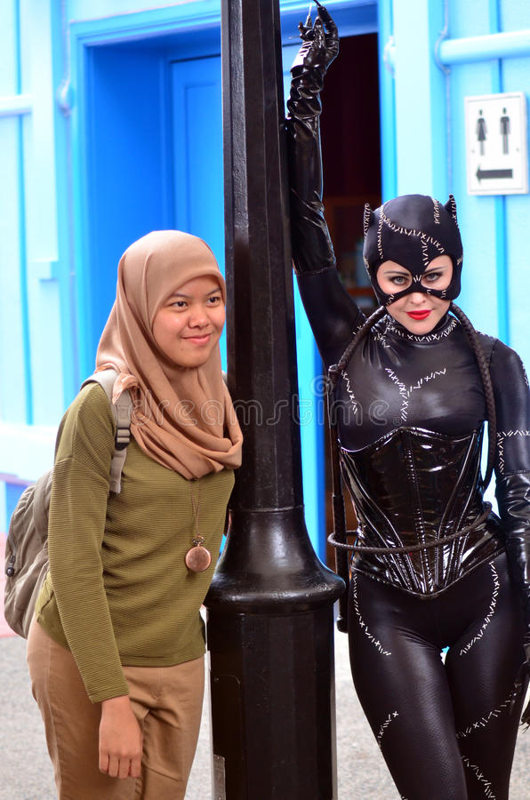 Catwoman. GOLD COAST, AUS - NOV 06 2014:Muslim woman with Catwoman in Movie World Gold Coast Queensland Australia.Catwoman was ranked 23rd in Comics Buyer's royalty free stock images