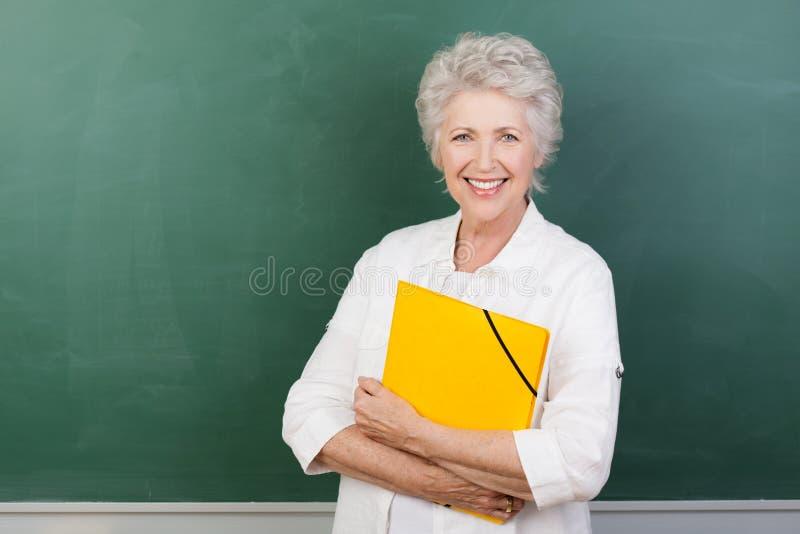 Caucaisna cheerful female senior teacher royalty free stock images