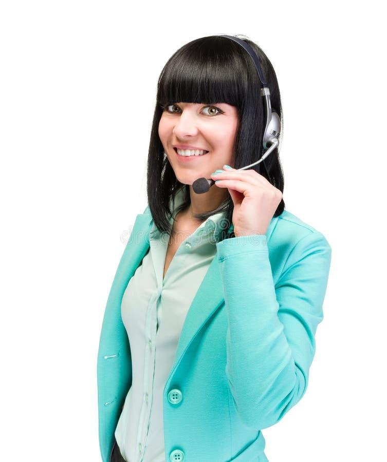 Caucasian affärskvinna med den isolerade hörlurar med mikrofon fotografering för bildbyråer