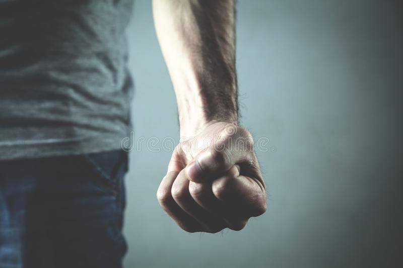 Caucasian angry and aggressive man threatening with fist. stock image