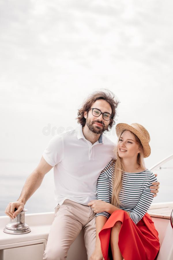 Young beautiful married couple embracing on the yacht on vacation royalty free stock photos