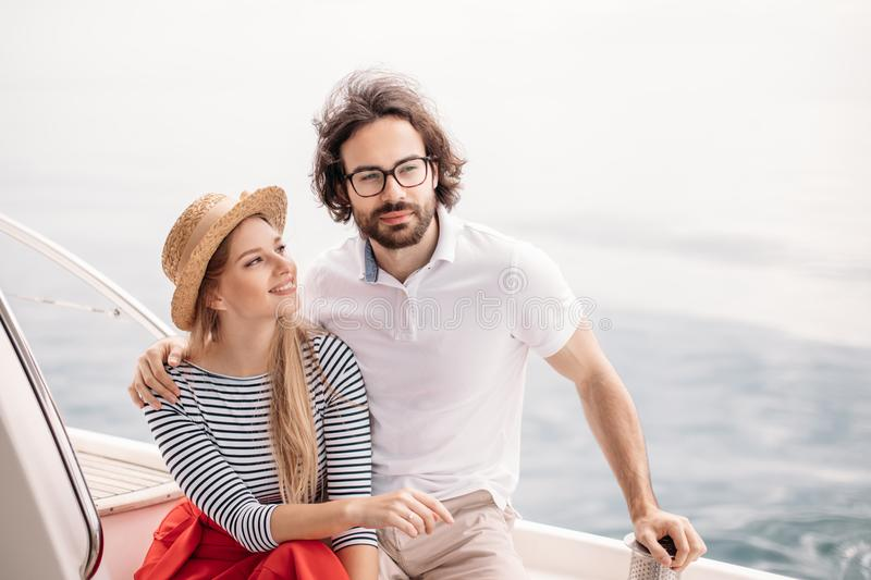 Young beautiful married couple embracing on the yacht on vacation stock photos