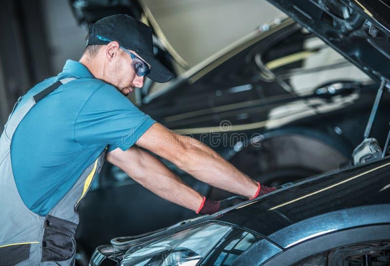 Worker Repairing Car royalty free stock images