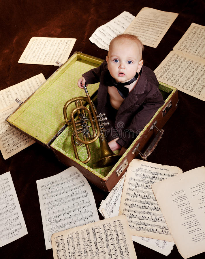 Free Caucasian Baby Boy Plays With Trumpet Royalty Free Stock Images - 30665919