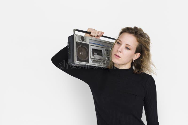 Caucasian begrepp för dam Holding Jukebox Neutral royaltyfri fotografi