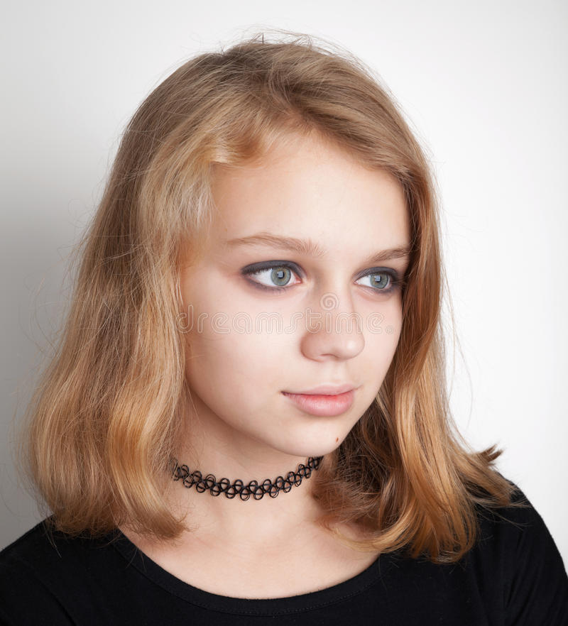 Caucasian blond teenage girl in black choker royalty free stock image