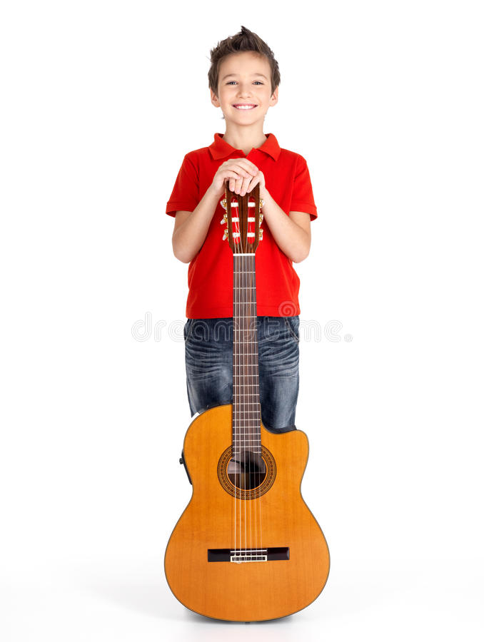Caucasian Boy With Acoustic Guitar Stock Photo