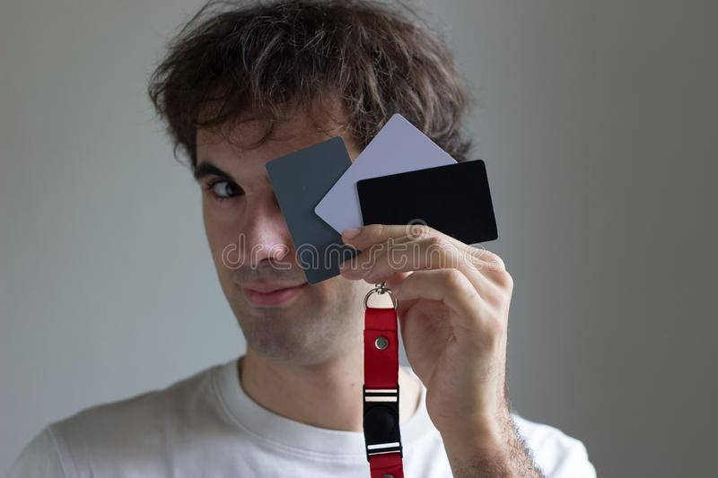 Caucasian boy with gray cards for photography stock photo