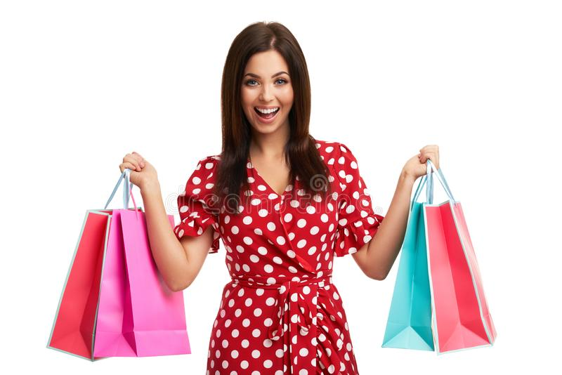 Caucasian brunette woman holding shopping bags isolated over white background stock images