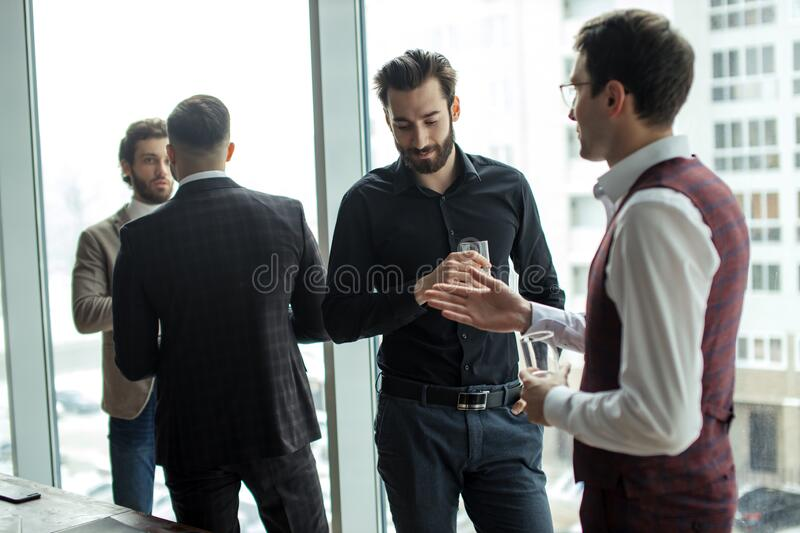 Caucasian business partners together in office stock photos