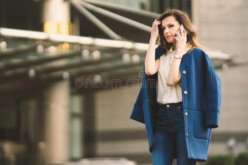 Caucasian business woman speaking by phone. Waist up portrait of a successful European business woman woman, talking on the phone stock photos