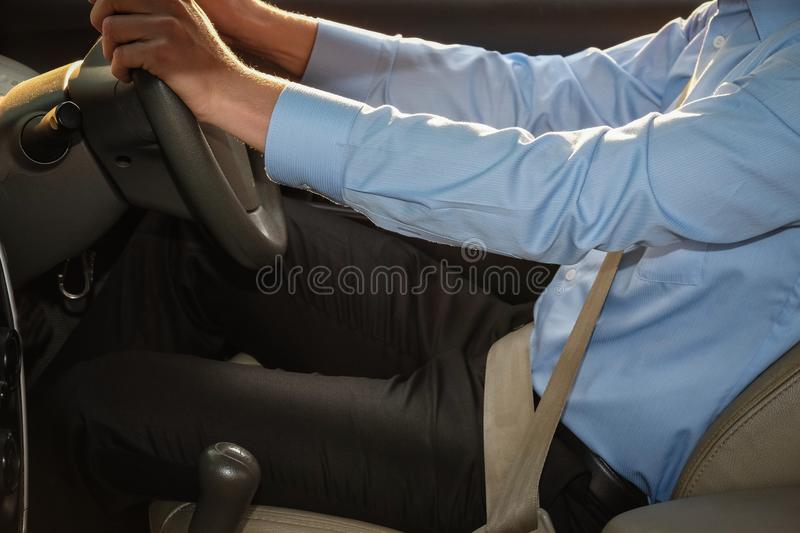 Businessman driving his car. male driver holding steering wheel. Caucasian businessman driving his car. male driver holding steering wheel royalty free stock photo