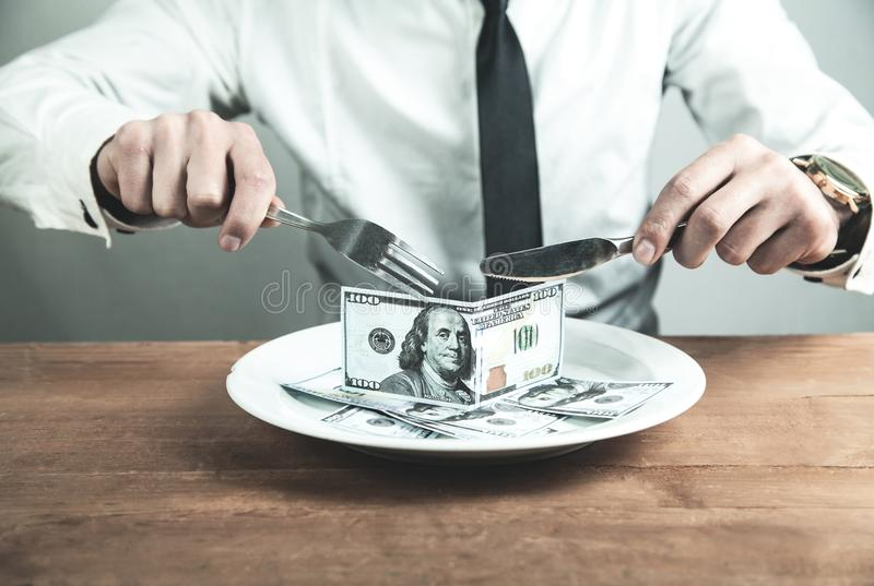 Caucasian businessman having dinner dollars. Business concept royalty free stock images