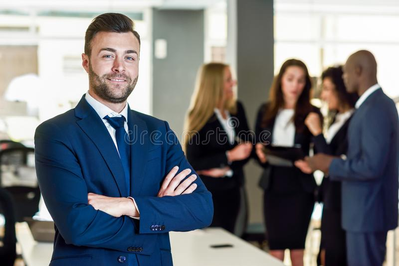 Businessman leader in modern office with businesspeople working royalty free stock photography