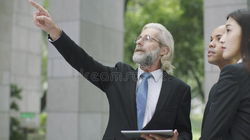Caucasian businessman pointing upward royalty free stock images