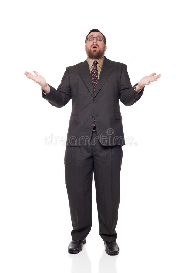 Caucasian businessman raising arms disbelief. Isolated full length studio shot of the front view of an upset businessman with open mouth, raising his arms in royalty free stock images