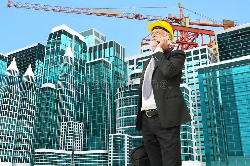 Caucasian Businessman use Digital Mobile phone at Construction S royalty free stock photos