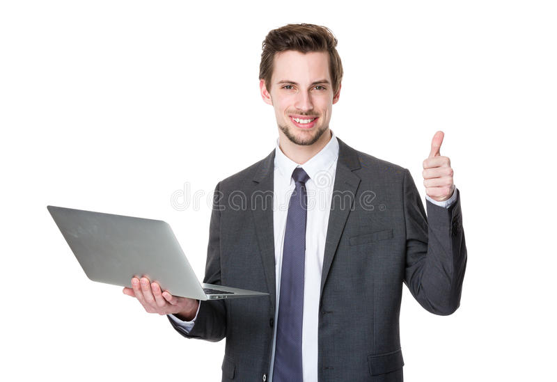 Caucasian businessman use of laptop and thumb up stock photography