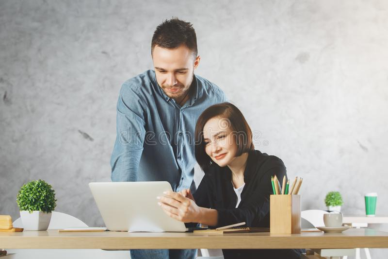 Caucasian businessman and woman working on project royalty free stock image